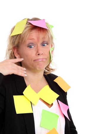 Businesswoman with post-it notes all over her. White background. photo