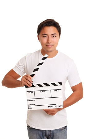 Man holding a film slate, wearing a t-shirt. White background. photo