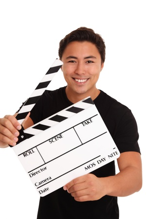 cinematographer: Man holding a film slate, wearing a t-shirt. White background. Stock Photo