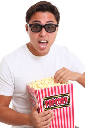 Man in 3d glasses holding a popcorn bucket  Wearing a white t-shirt  White background  photo