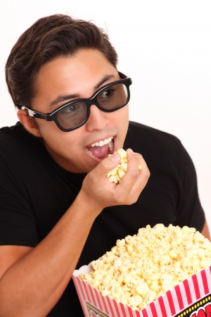 Man in 3d glasses holding a popcorn bucket  Wearing a black t-shirt  White background  photo