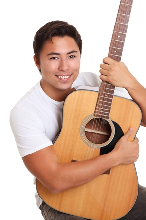 Young singer-songwriter sitting down with an acoustic guitar, wearing a white t-shirt  White background  photo