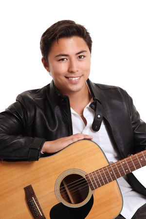 Young singer-songwriter sitting down with an acoustic guitar, wearing a white shirt and a black leather jacket  White background  photo