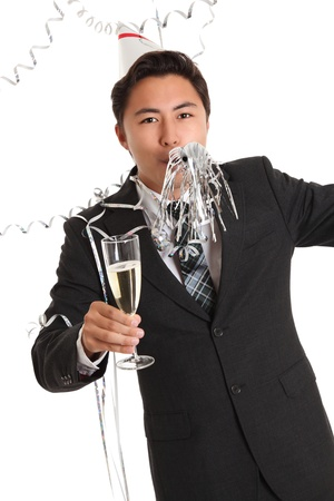 Its a PARTY! Wearing a suit, tie and party hat. Holding a champagne glass. White background. photo