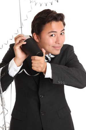 Party guy with cocktail shaker wearing a suit and tie. White background. Stock Photo - 17417036