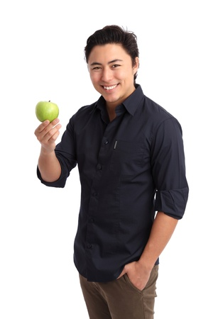 Healthy living. Man holding a green apple wearing a blue shirt. White background. photo