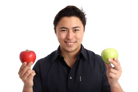 Man holding a red and green apple. Wearing a blue shirt. White background. Stock Photo - 17424667