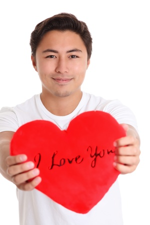 I Love You. A young man holding a soft heart with the words I Love You. White background. Stock Photo