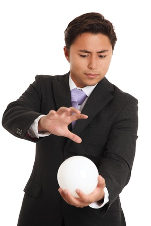 Businessman with a glassball, looking in to the future. White background.