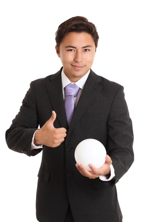 Futures looking great. Businessman with a glassball, looking in to the future. White background. photo