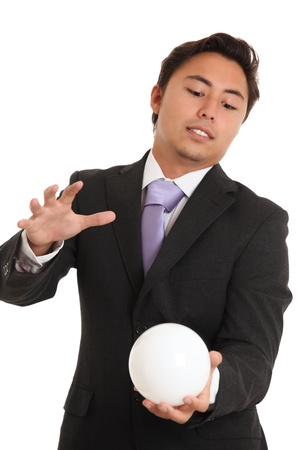 Businessman with a glassball, looking in to the future. White background. Stock Photo - 17424685