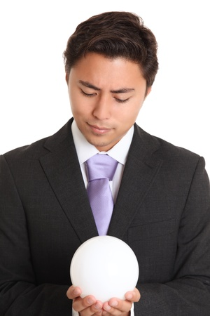 Businessman with a glassball, looking in to the future. White background. photo