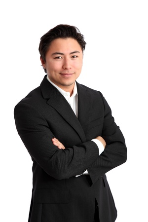 Young satisfied businessman with his arms crossed wearing a suit. White background.