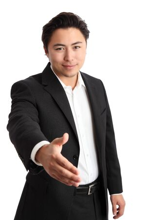 Young relaxed businessman wearing a suit. White background. photo