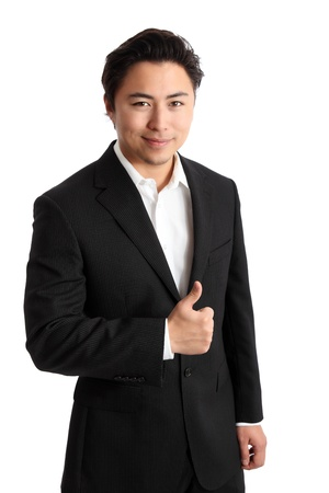 Young businessman in a suit, doing thumbs up. White background.