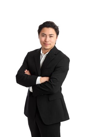 space suit: Young satisfied businessman with his arms crossed wearing a suit. White background.