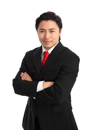 Young satisfied businessman with his arms crossed wearing a suit and tie. White background. photo