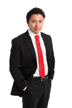Young relaxed businessman wearing a  suit and red tie. White background. photo