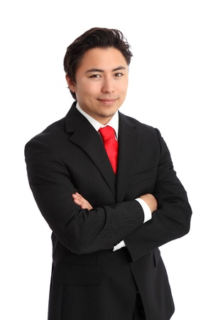 Young satisfied businessman with his arms crossed wearing a suit and tie. White background.