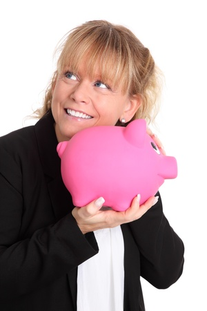 Savings for my future, cute female holding a piggybank up to her ear. White background. photo
