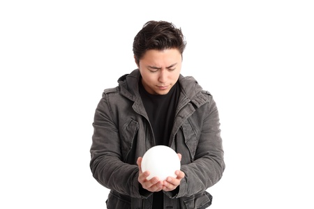 Man looking into the future, wearing a jacket holding a glass ball. White background. Stock Photo - 17477891