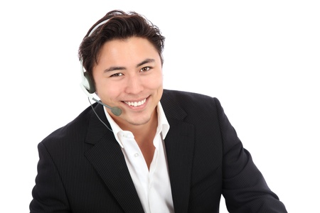 Young man on support line, wearing a headset with a black suit and white shirt. White background. Stock Photo
