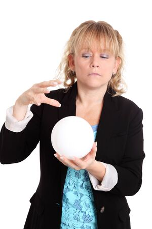 Woman looking in to the future holding a glass ball. White background. photo