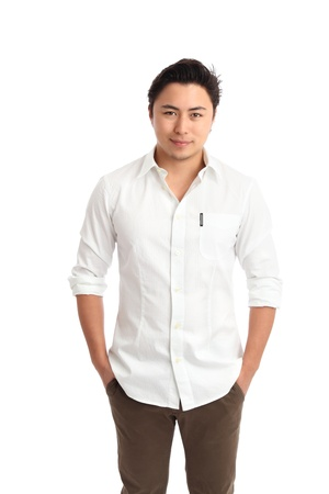 white shirt: Relaxed young man in a white shirt with his hands in his pockets  White background