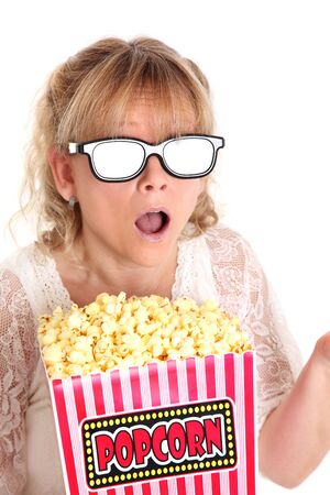 OMG  Woman with a popcorn bucket and 3-d glasses gasping  White background  photo