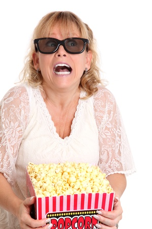 Ohh thats scary  Woman with a popcorn bucket and 3-d glasses gasping  White background  photo