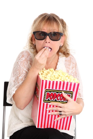 Woman with a popcorn bucket and 3-d glasses laughing  White background Stock Photo - 18068691