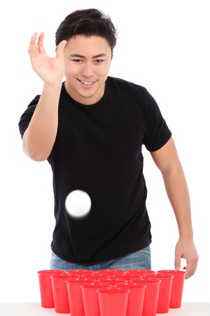 Beer pong player wearing a black t-shirt throwing a ball. White background.