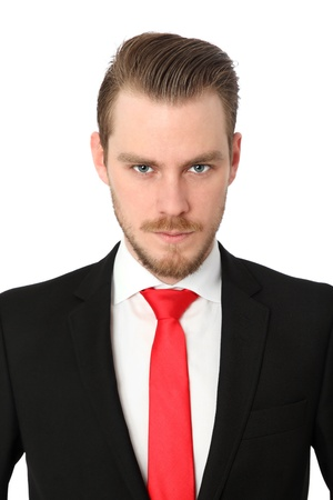 Serious businessman wearing a suit and red tie  White background  photo