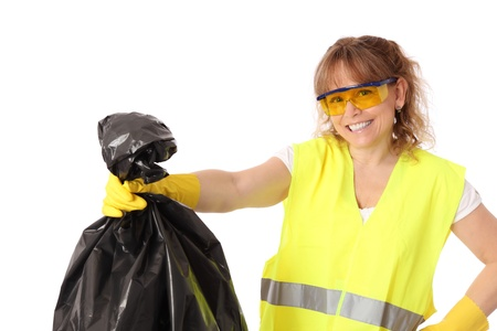 Female wearing safety clothes holding a garbage bag  White background  Stock Photo