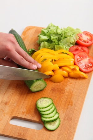 Close up of chef preparing a salad  White background  photo