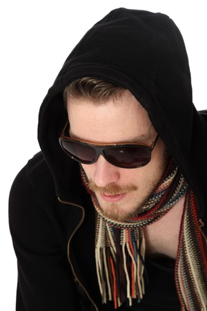 Close up of a man wearing sunglasses with a black hoodie, and a scarf photo
