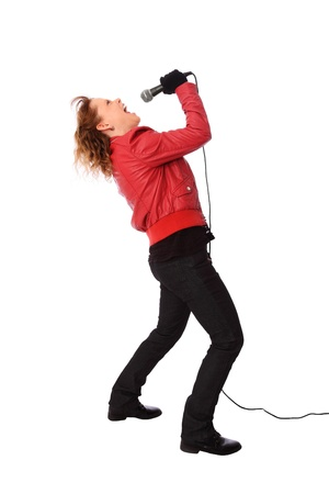 Cool looking rocker chic wearing a red leather jacket, screaming in a microphone  White background  photo