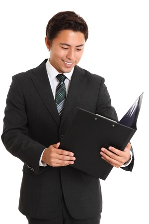 Young attractive man wearing a suit and tie, holding a folder  White background  Stock Photo