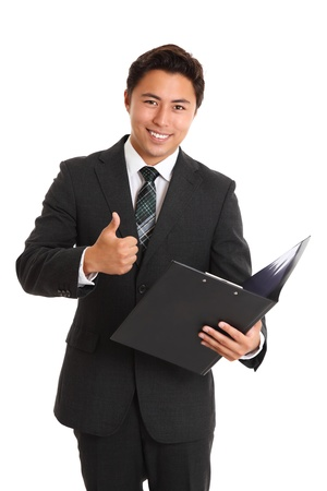 Young attractive man wearing a suit and tie, holding a folder doing thumbs up  White background  Stock Photo