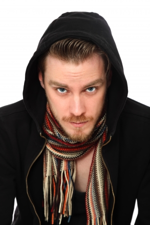Macho man in a hoodie with a scarf  White background  photo