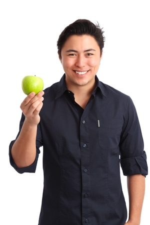 Healthy living  Man holding a green apple wearing a blue shirt  White background  Stock Photo