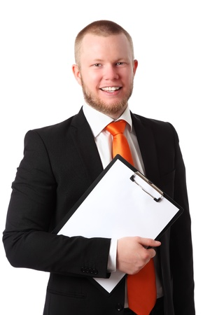 Young attractive businessman wearing a suit and orange tie, holding a clipboard  White background  photo