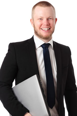 Young good looking businessman with a laptop, wearing a suit and tie  White background  photo