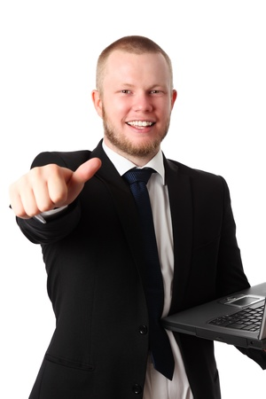 Young good looking businessman with a laptop, wearing a suit and tie doing thumbs up  White background  photo