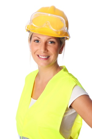 reflective vest: Young attractive female construction worker wearing a reflective vest and hard hat  White background