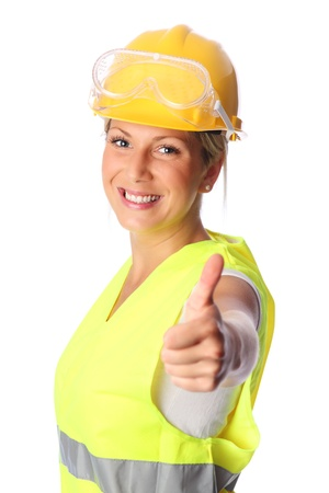 Young attractive female construction worker wearing a reflective vest and hard hat  White background  photo