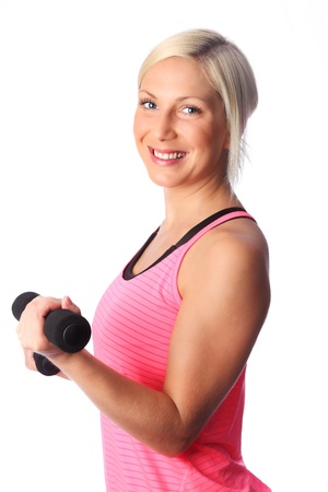 Attractive Young woman working out, wearing a pink top  White background  Stock Photo