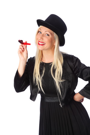 Beautiful party lady wearing a black dress and top hat holding a blower   photo