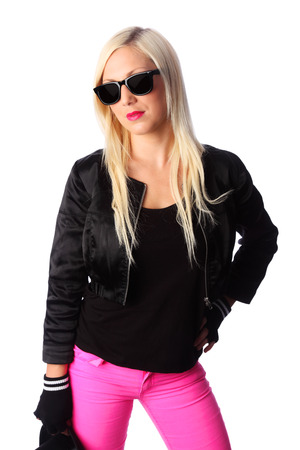 Cool woman standing with pink pants and a black jacket  Wearing a black top hat and black sunglasses   photo
