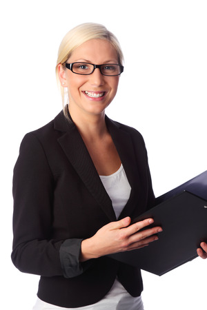 Cute and attractive businesswoman wearing a black suit and glasses, holding a document folder photo
